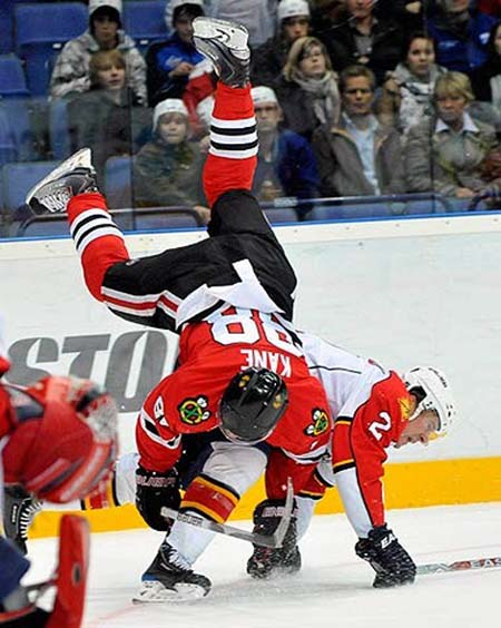 Keith Ballard hip checks Patrick Kane